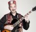 Ajutor umanitar | Omul şi chitara sa – Capriel Dedeian
