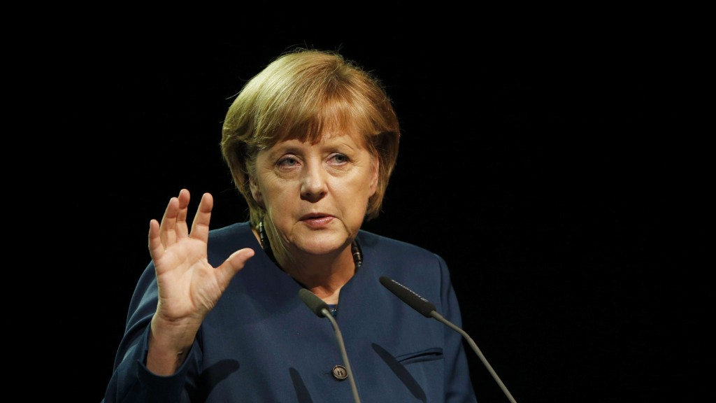 German Chancellor Merkel gestures as she gives a speech at German sustainable development congress in Berlin