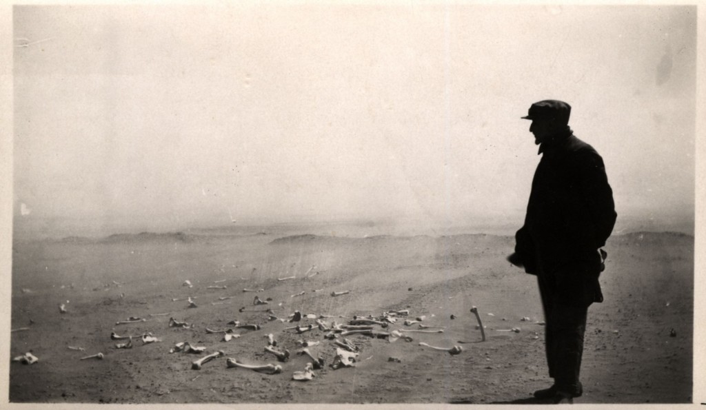 Armenian looking at the human remains of the terrible massacres at Der el Zor in 1915 1916. AGMI