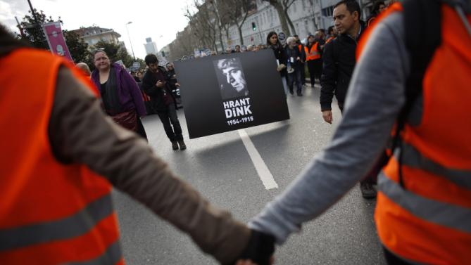 Protesters march during a demonstration to mark the eighth anniversary of the killing of Turkish-Armenian editor Hrant Dink as they carry his portrait in Istanbul